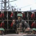 מחבלי חמאס ומשגר רקטות // צילום: אנדולו