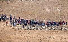 פליטים סורים שהתקרבו לגדר הגבול עם ישראל // צילום: אי.אף.פי